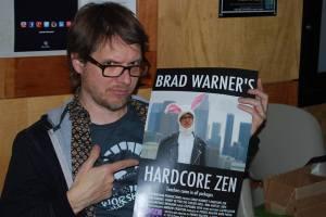brad holding doc poster